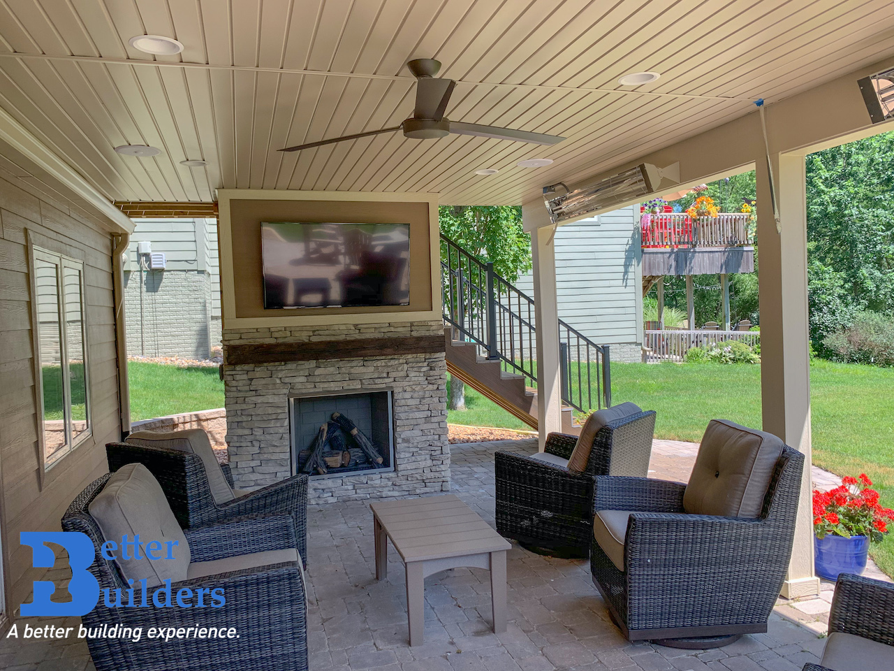 Outdoor fireplace built into feature wall design for entertainment.